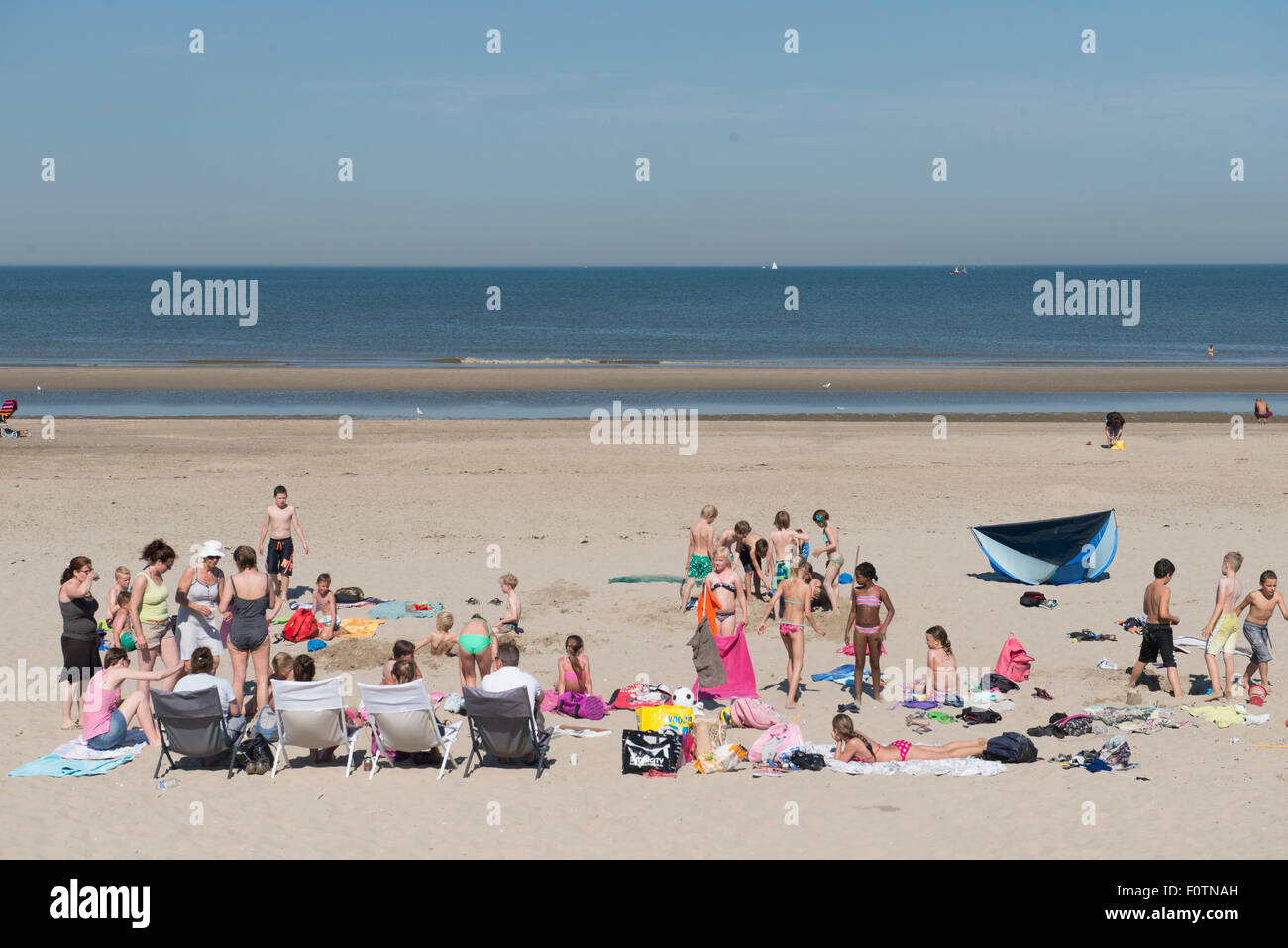 Holidaymakers on the beach, Bergen, Netherlands - Stock Image