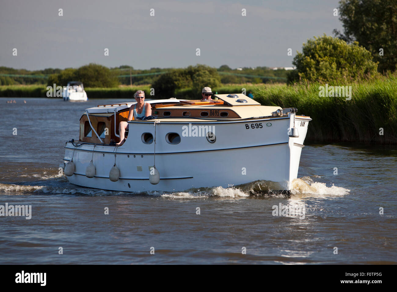 Vintage motor cruiser on the Norfolk Broads - Stock Image
