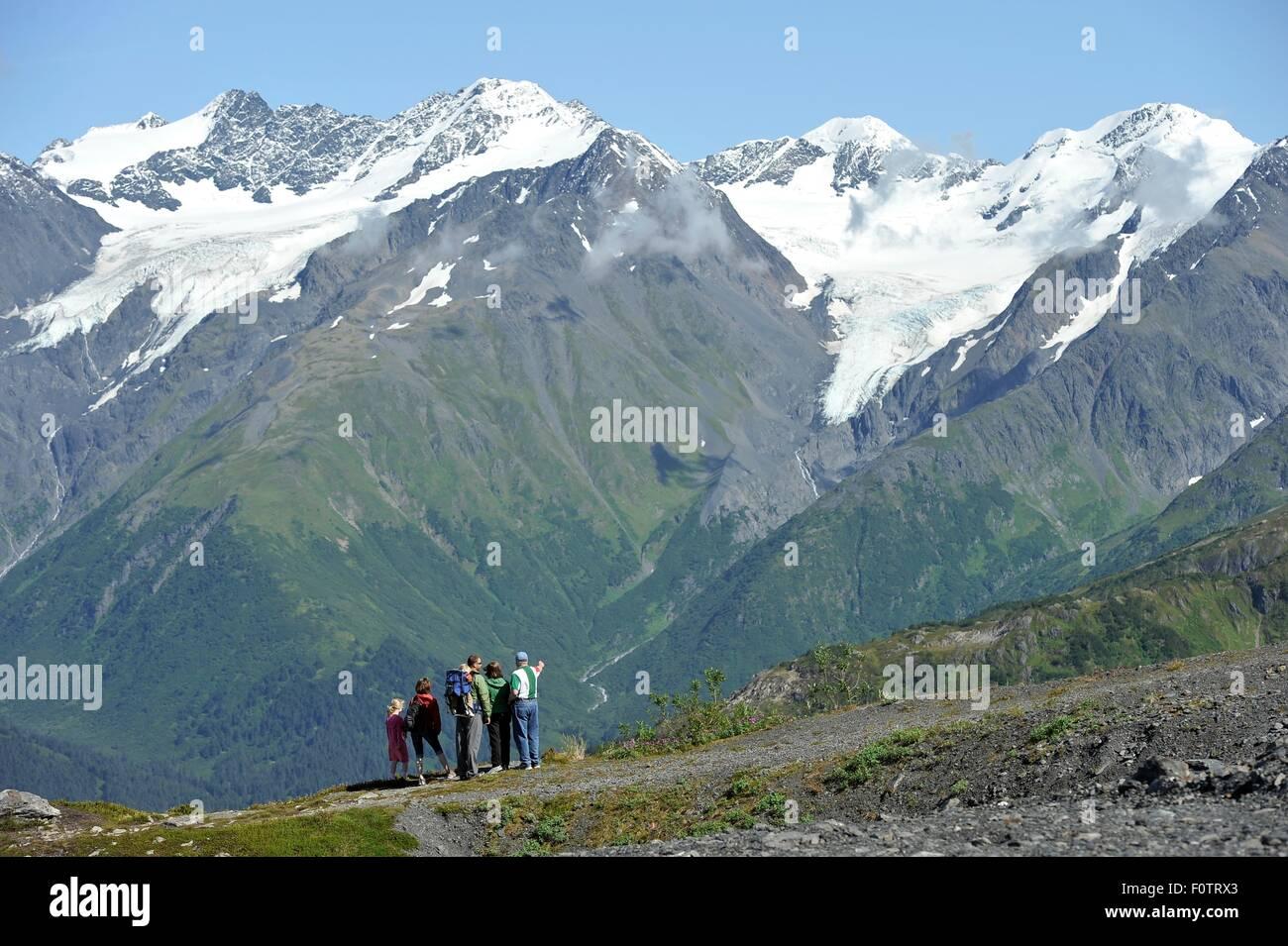 Group of people looking at view, Mighty Might Trail, Alyeska Resort, Winner Creek Valley, Turnagain Arm, Girdwood, - Stock Image