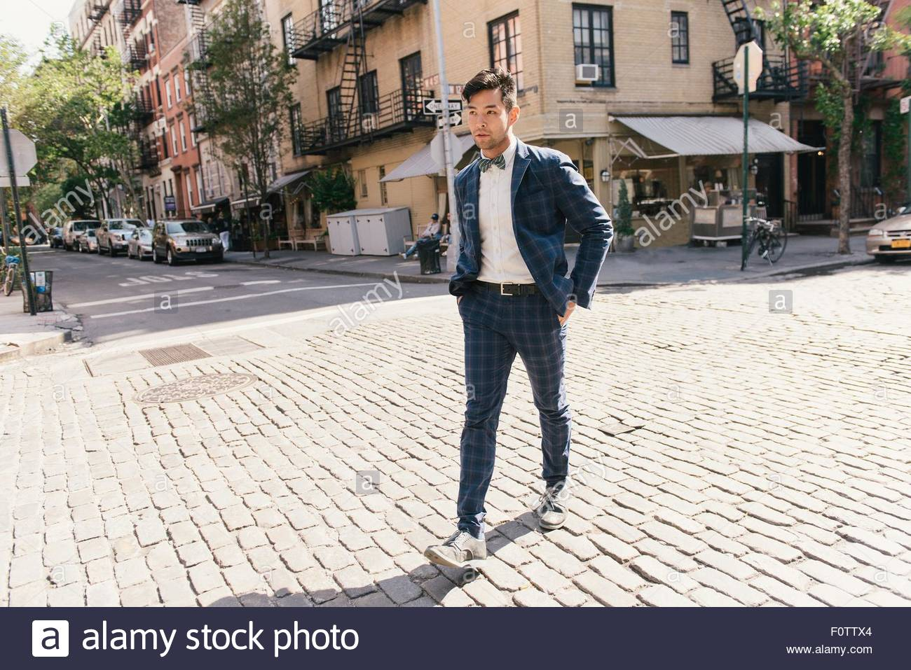 Worried businessman crossing road, West Village, Manhattan, USA - Stock Image