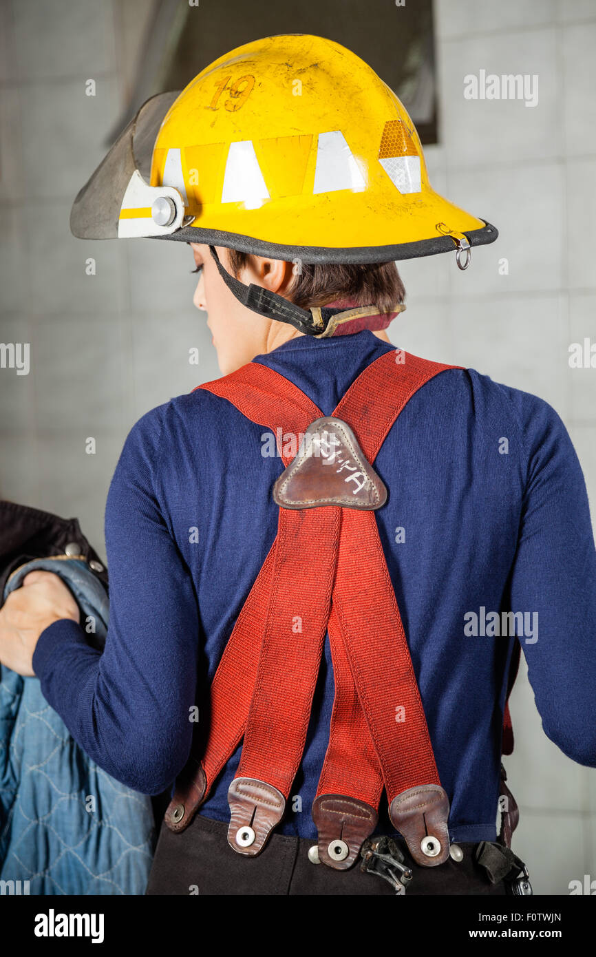 Rear View Of Firewoman In Uniform - Stock Image
