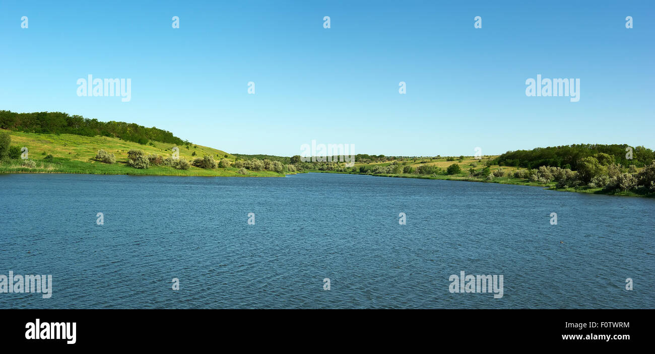 the river and the green hills. Nature composition. Stock Photo