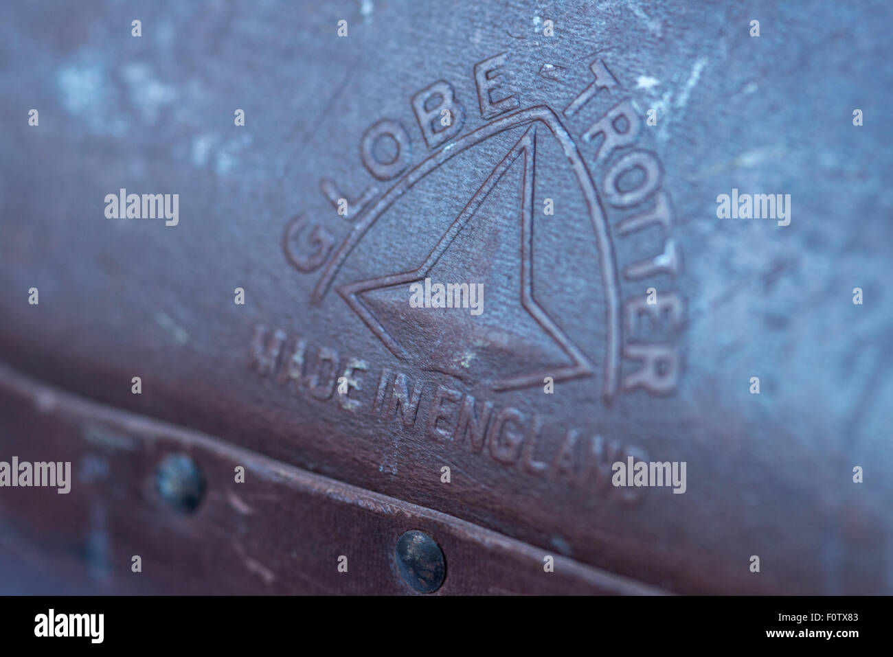 Made in England embossed stamp on Globe Trotter Suit case. - Stock Image