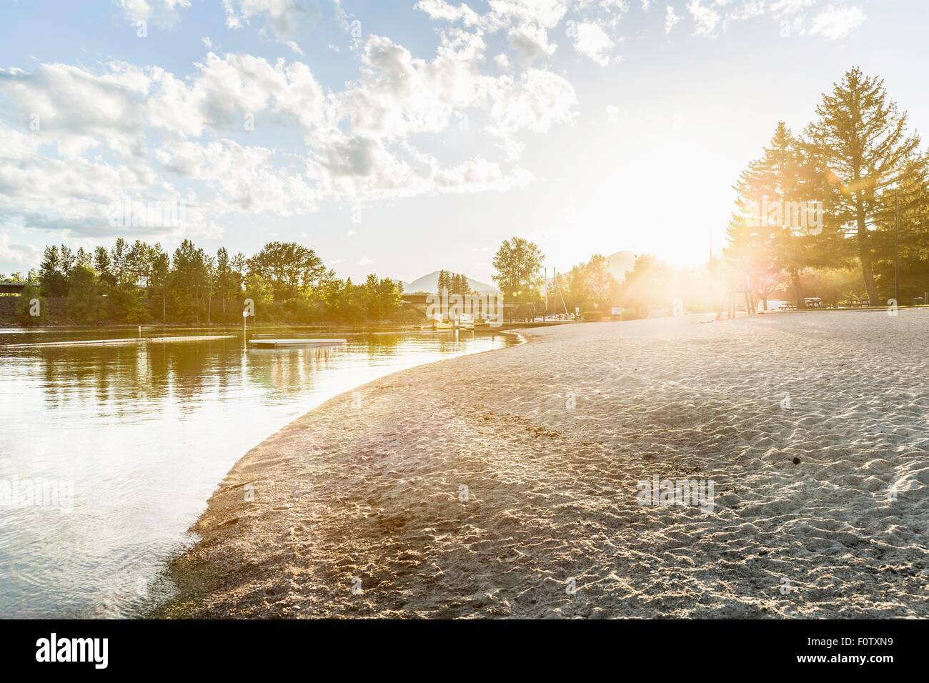 Empty beach at waters edge, Sand Point, Idaho, USA - Stock Image