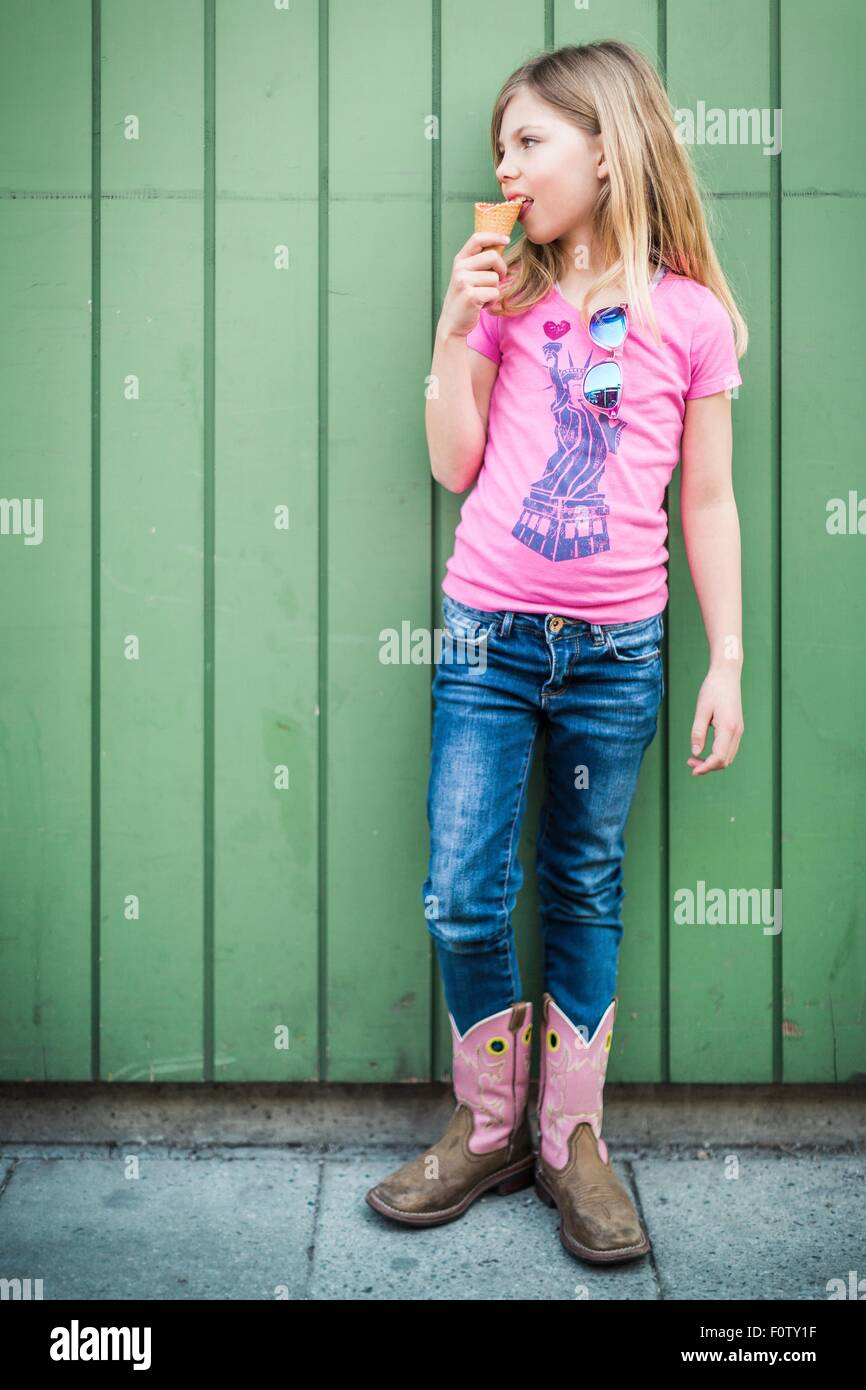 Portrait of young girl eating icecream - Stock Image