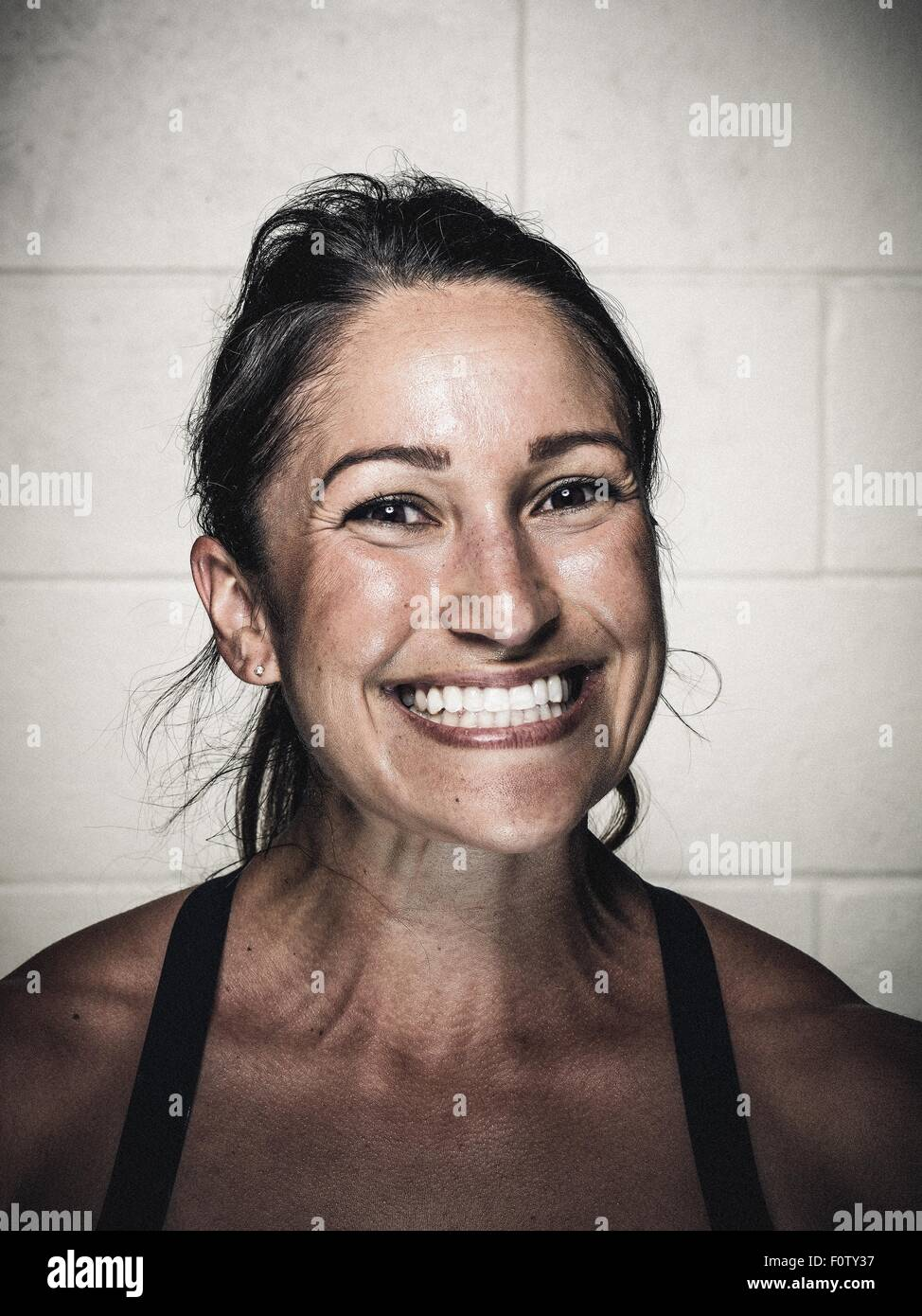 Portrait of a young woman after workout - Stock Image