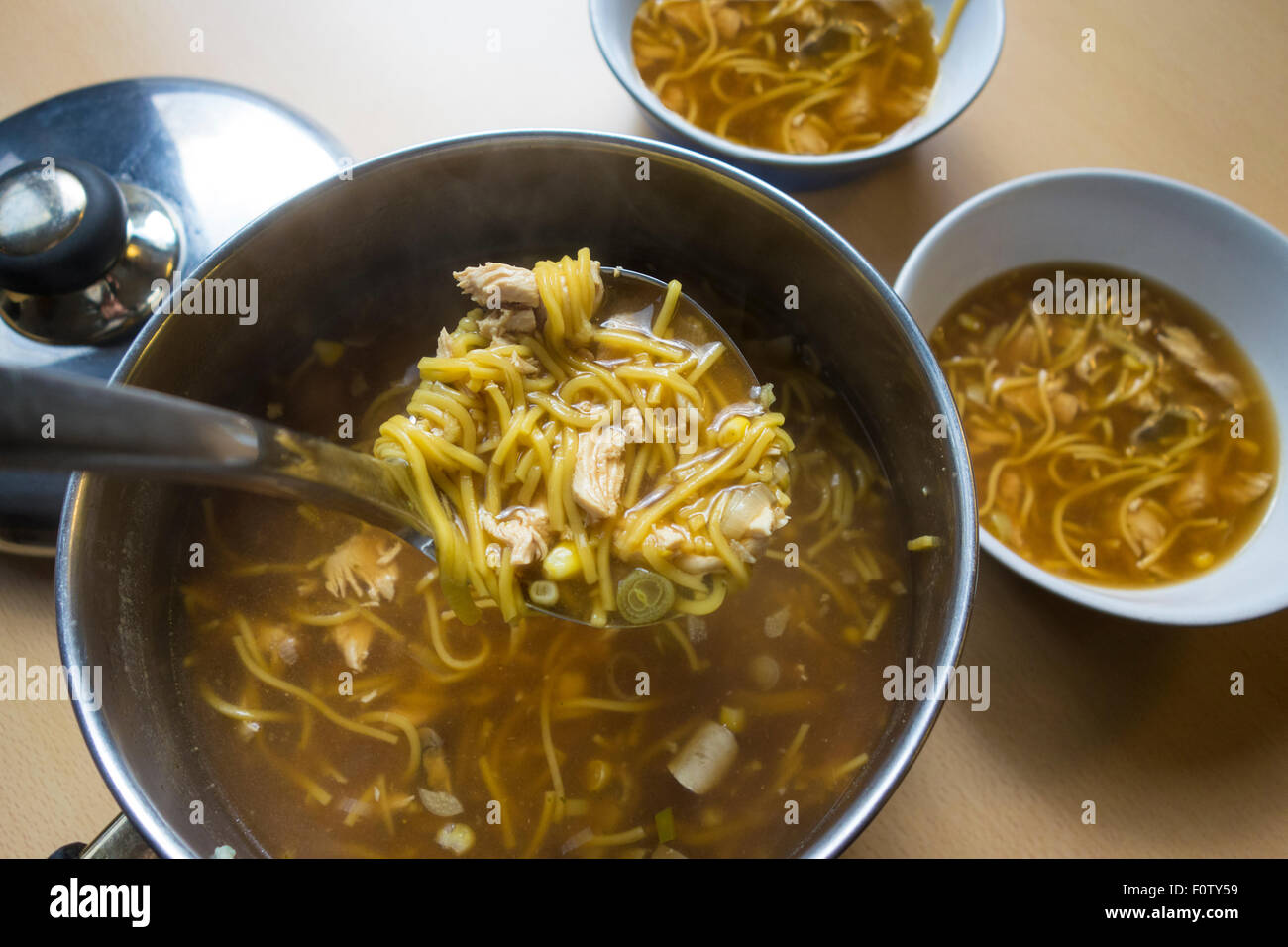 Home-made chicken noodle soup - Stock Image