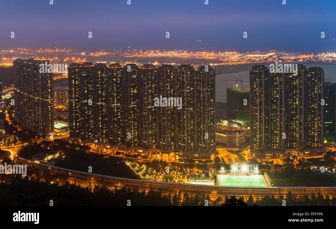 Tung Chung apartment buildings and Hong Kong airport, Hong Kong, China - Stock Image