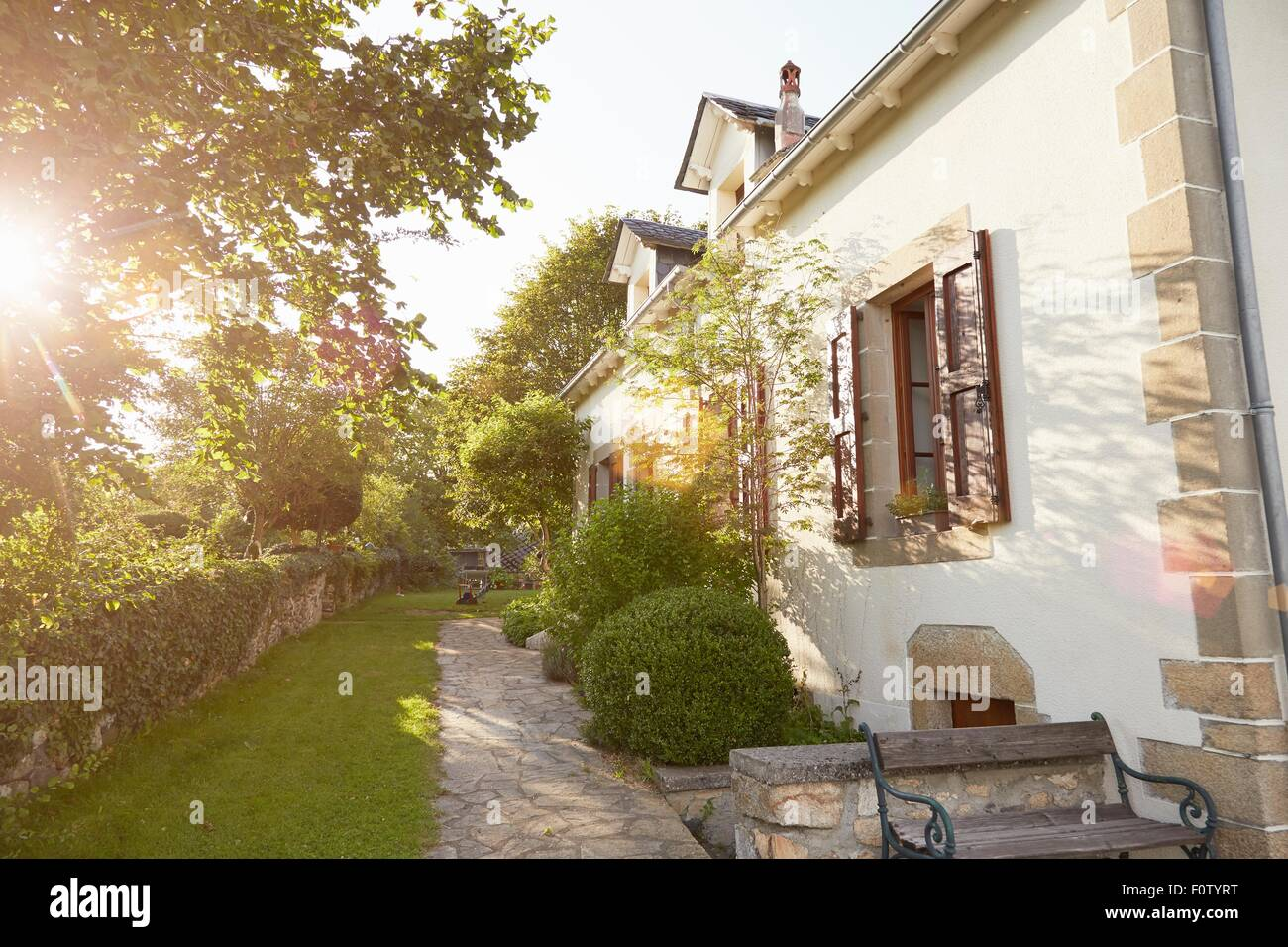 Rural cottage and garden in sunlight - Stock Image