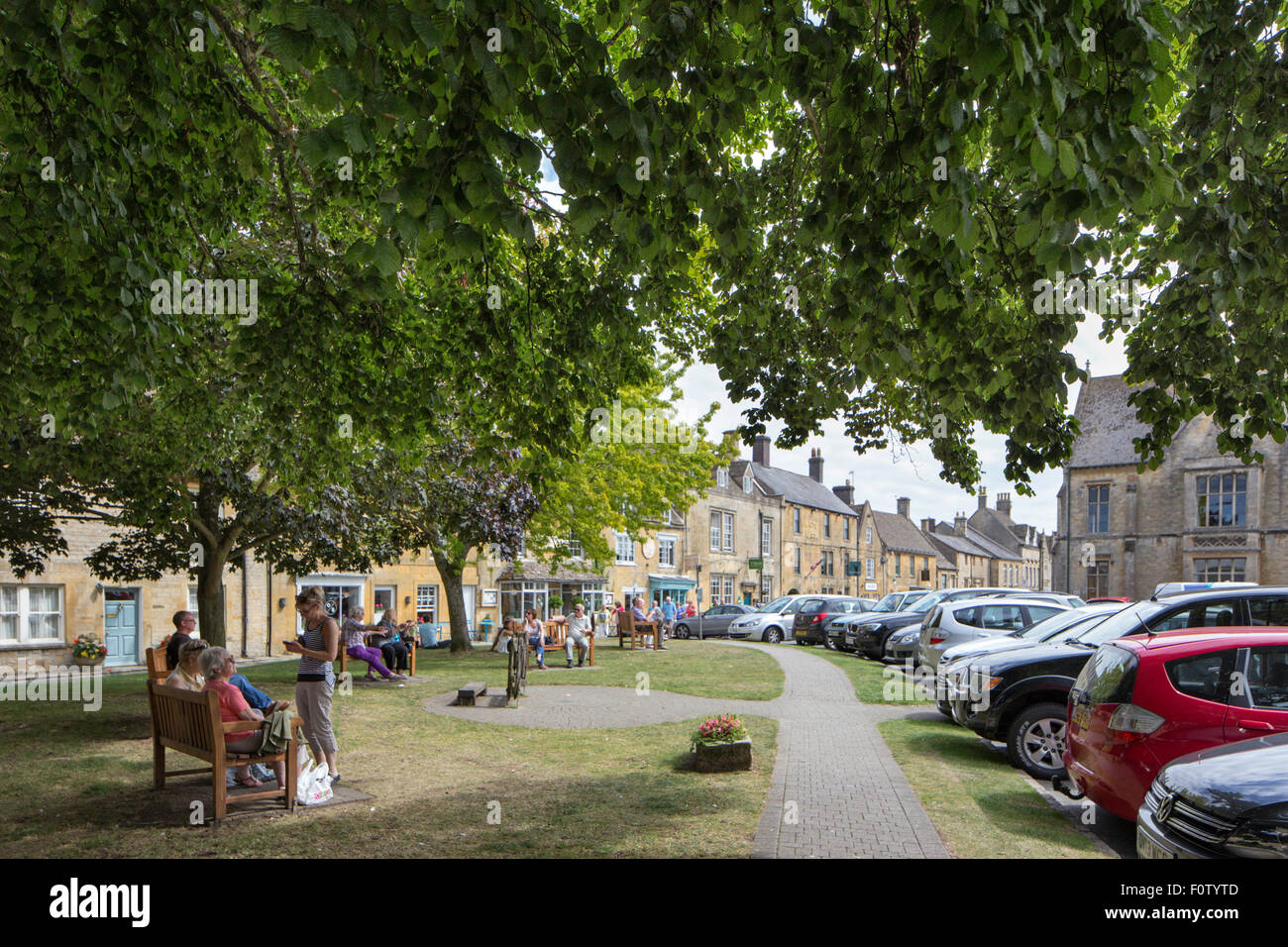 Relaxing in Stow on the Wold, Gloucestershire, England, UK Stock Photo