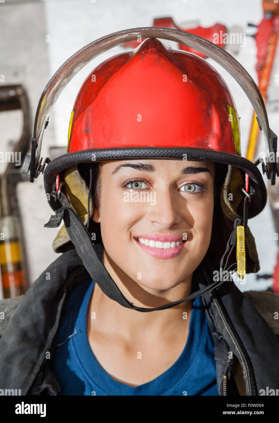 Happy Firewoman At Fire Station - Stock Image