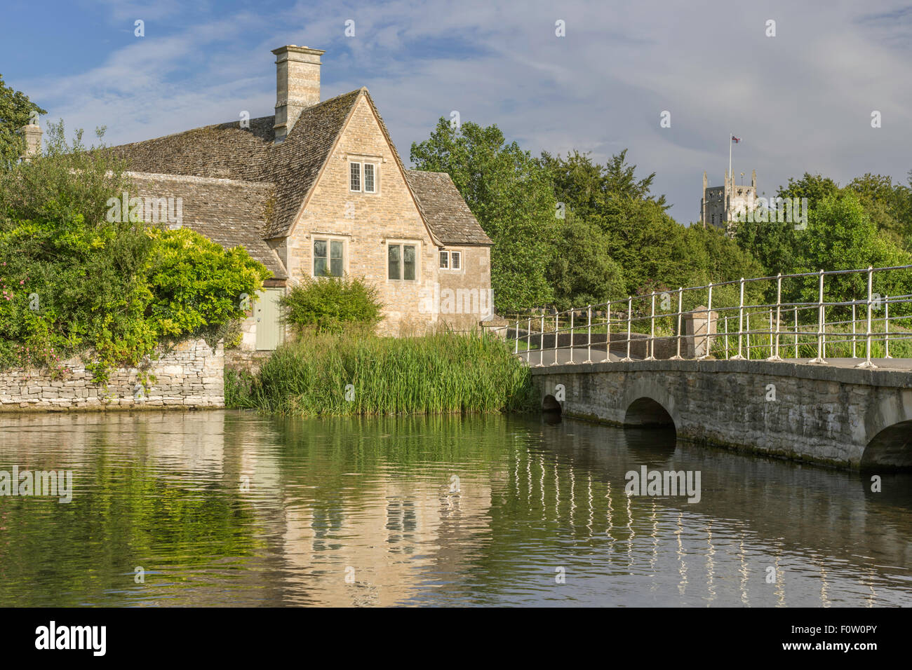 Fairford Mill on the River Coln, in the Cotswold market town of Fairford, Gloucestershire, England, UK - Stock Image