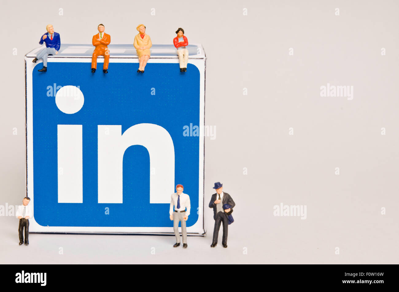 miniature figurines and Linkedin logo, social media, social interactions and social relationships concept - Stock Image