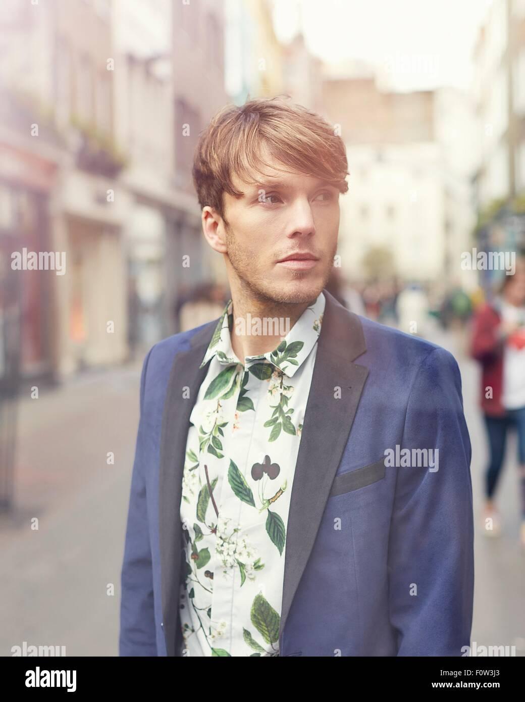Portrait of stylish mid adult man on street, London, UK - Stock Image