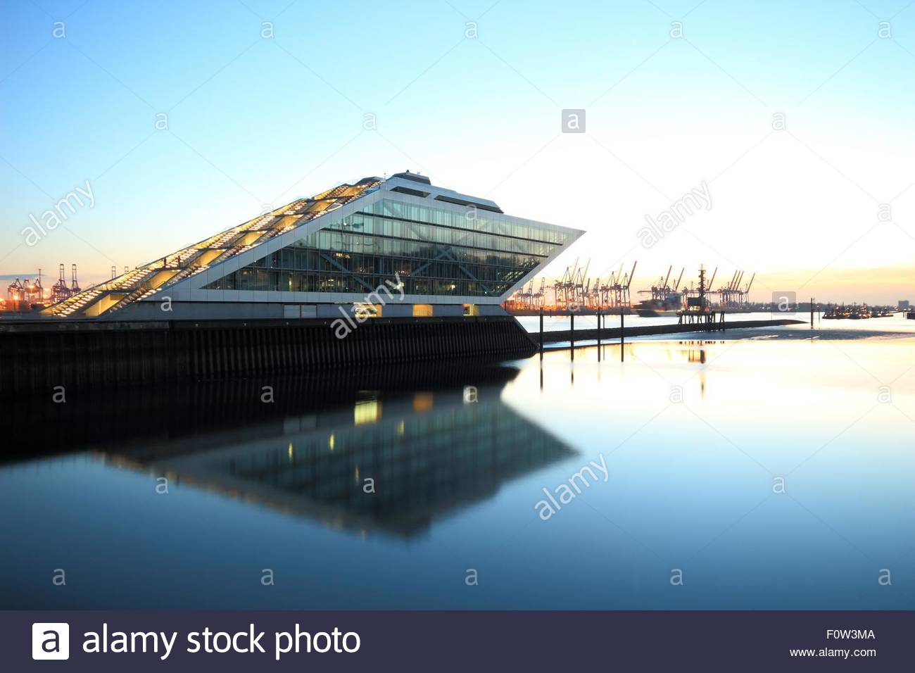 View of dockland office building on river Elbe at dusk, Hamburg, Germany - Stock Image