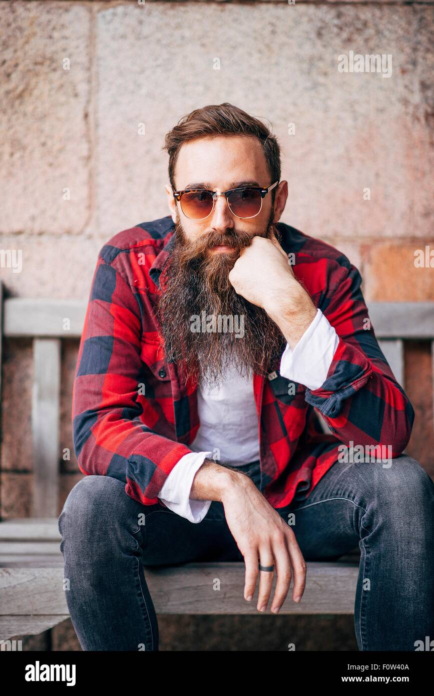 Portrait of man with beard wearing sunglasses - Stock Image