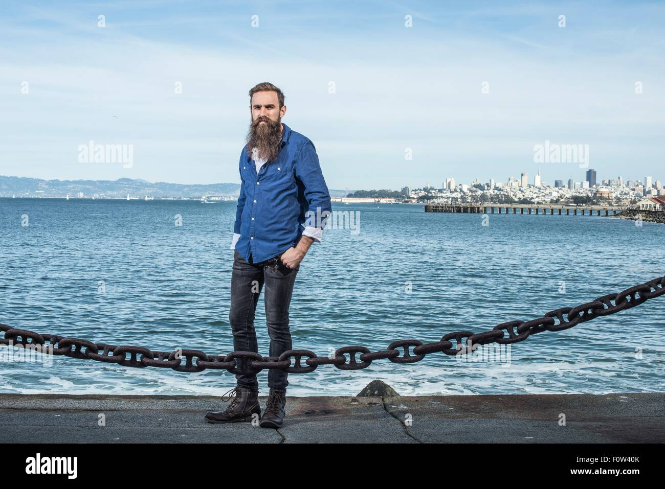 Man with beard standing at Port Point, San Francisco, California, USA - Stock Image