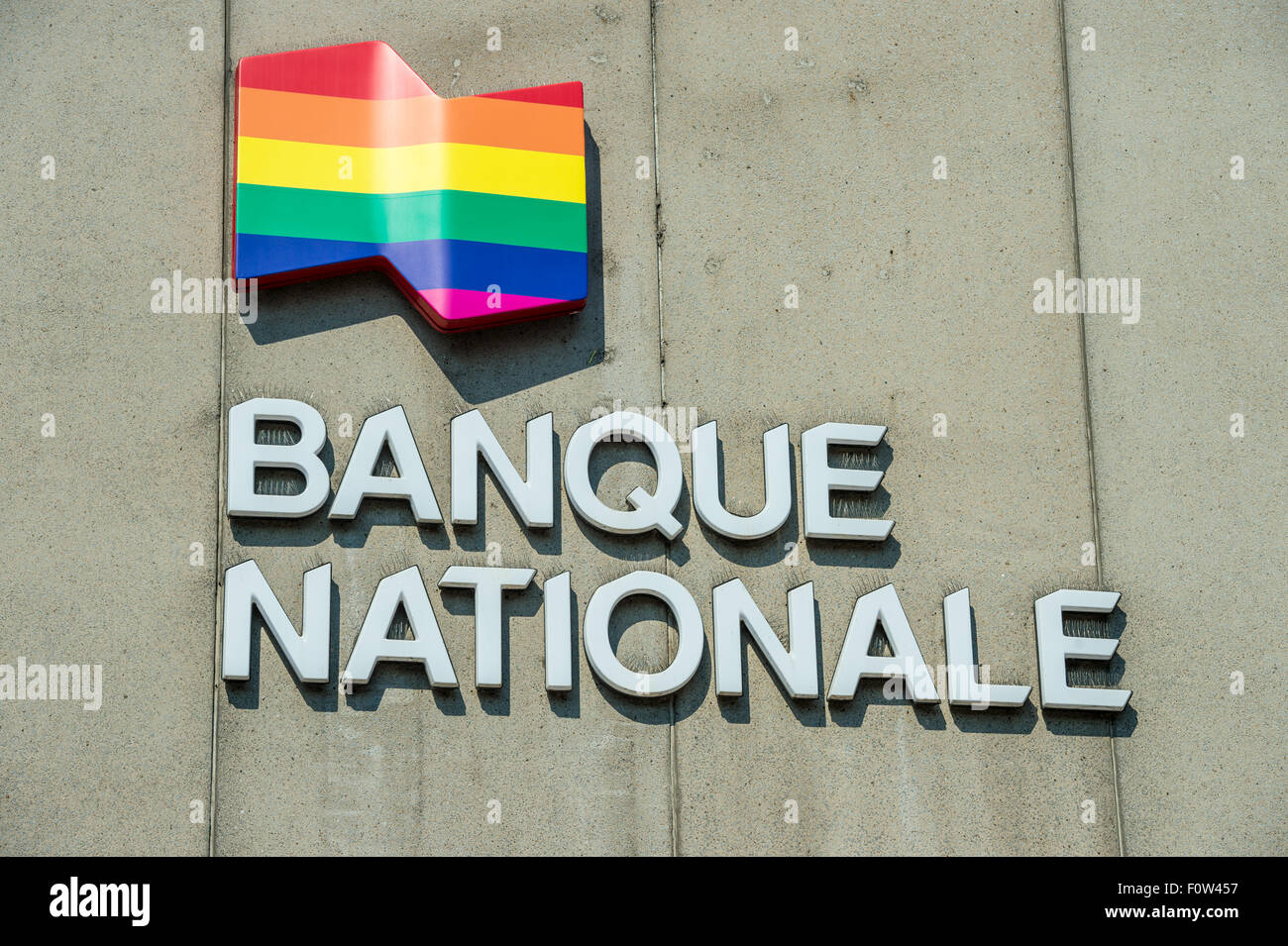 Banque Nationale (National Bank) displays the rainbow flag celebrating the gay pride week in Montreal, Canada - Stock Image