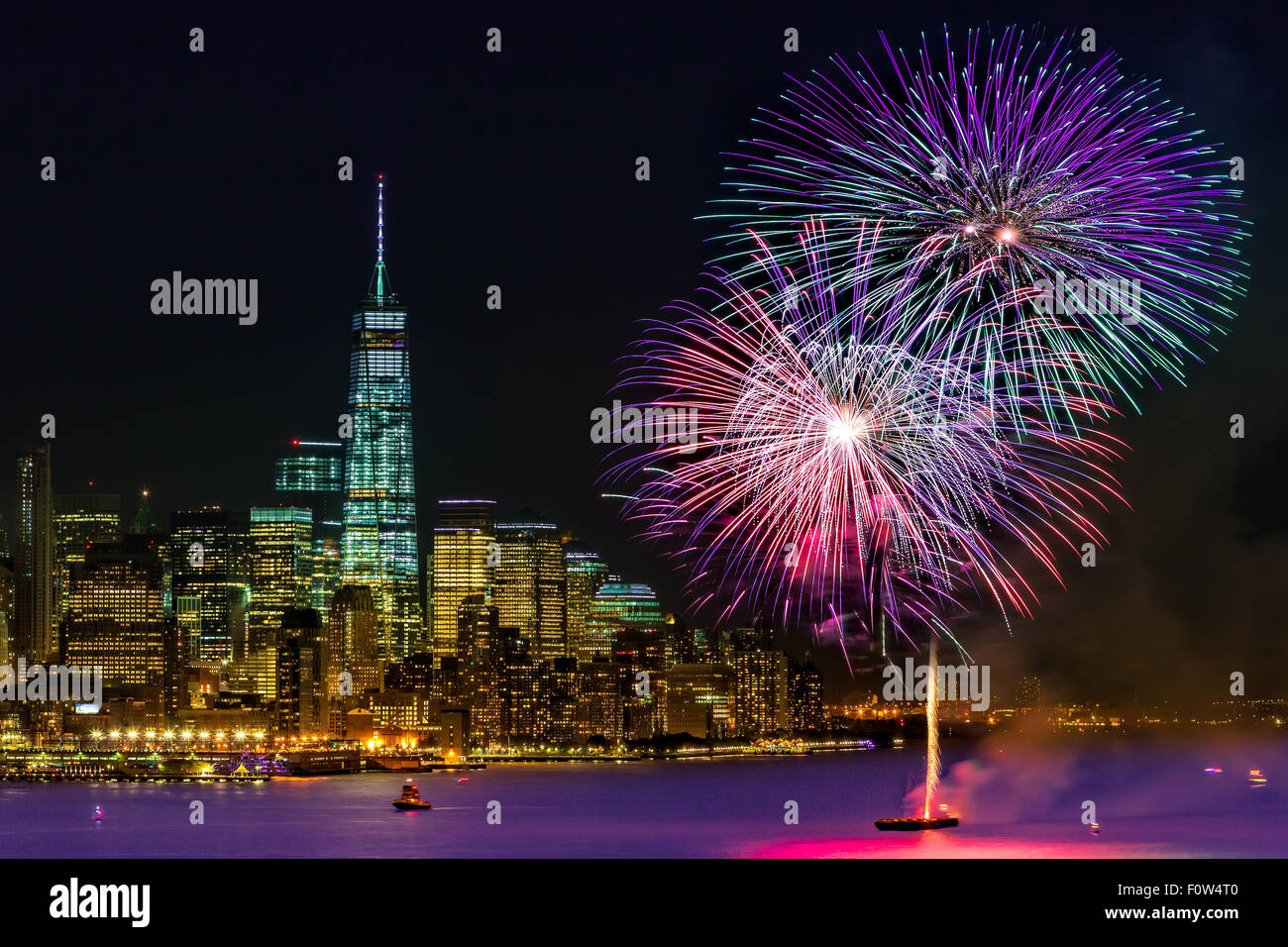 New York City Summer Fireworks - Fireworks Summer display celebration on the Hudson River by Chelsea Pier with One Stock Photo