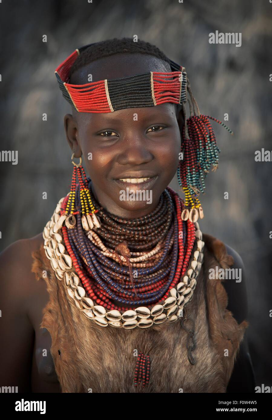 Portrait of girl from Karo tribe wearing traditional costume, Ethiopia, Africa - Stock Image