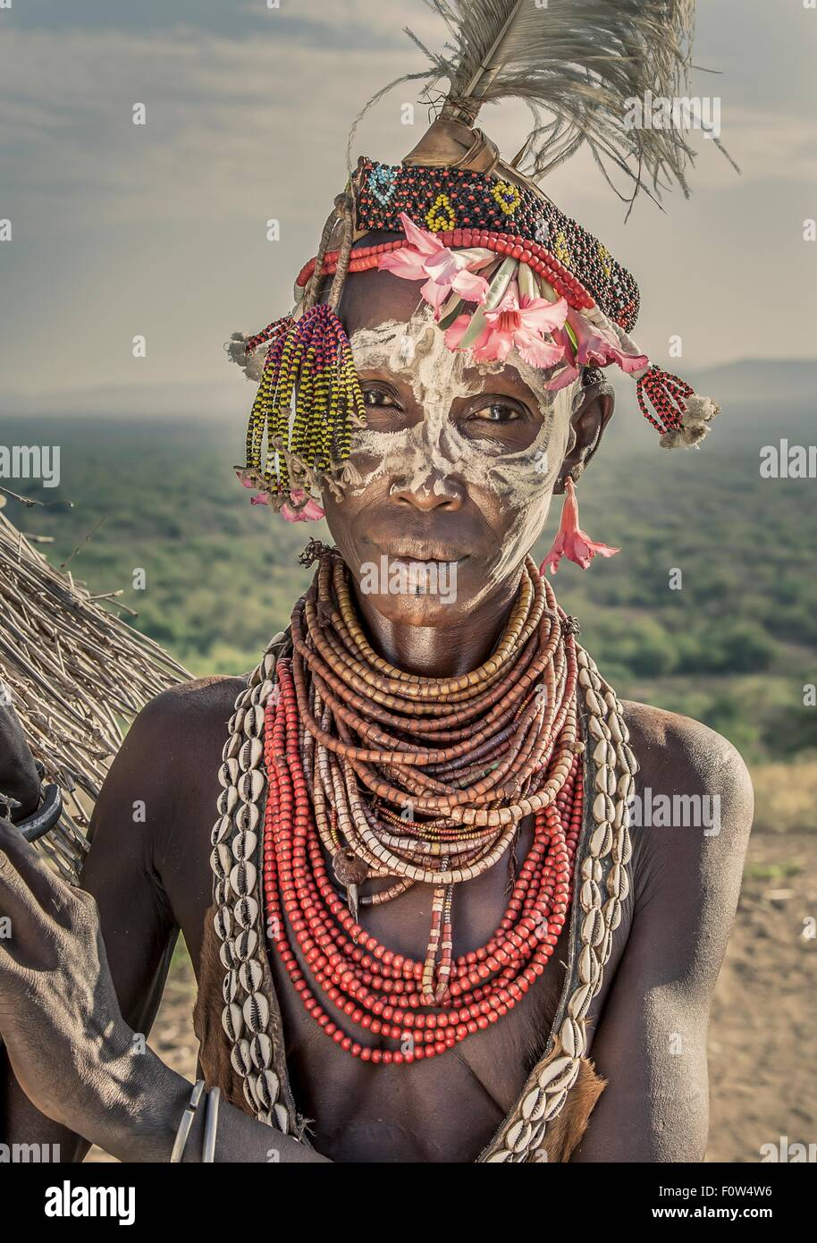 Portrait of mature woman from Karo tribe wearing traditional costume, Ethiopia, Africa - Stock Image