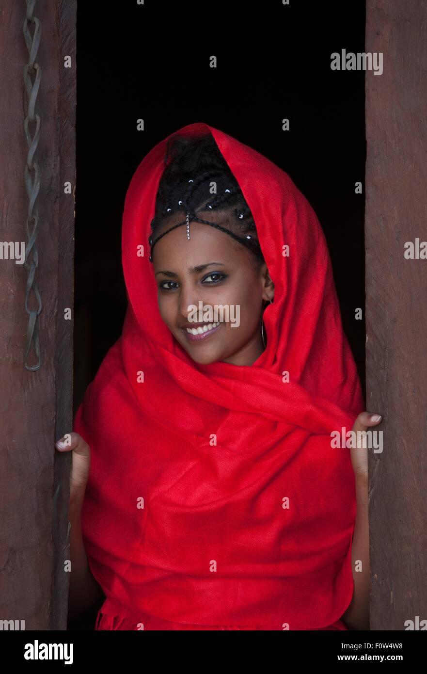 Portrait of young Amhara woman at open door, Ethiopia, Africa - Stock Image