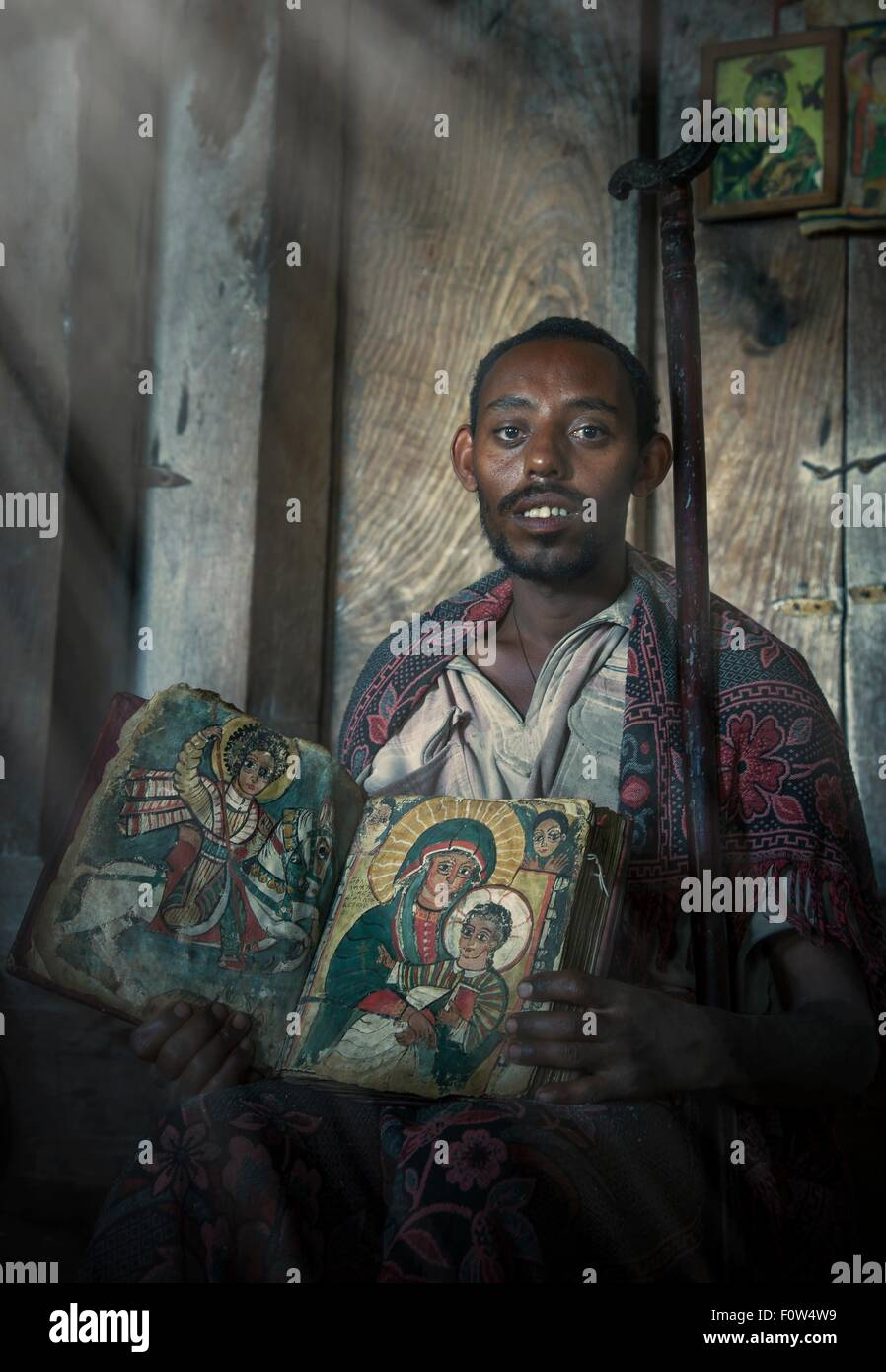 Portrait of priest with an old religious book in Ashen Maria Monastery, Lalibela, Ethiopia, Africa - Stock Image