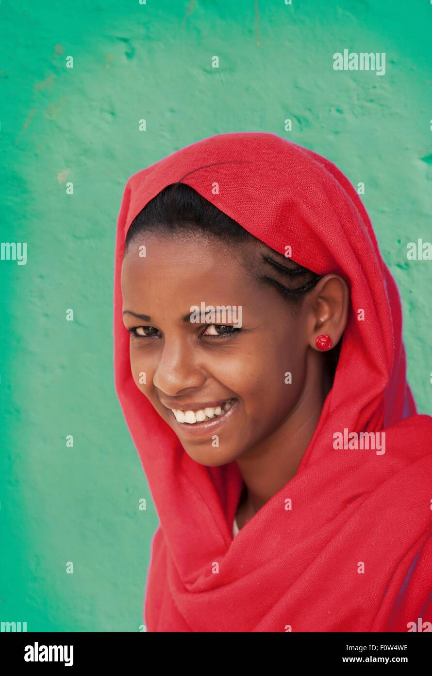 Portrait of Amhara woman wearing red headscarf, Ethiopia, Africa - Stock Image