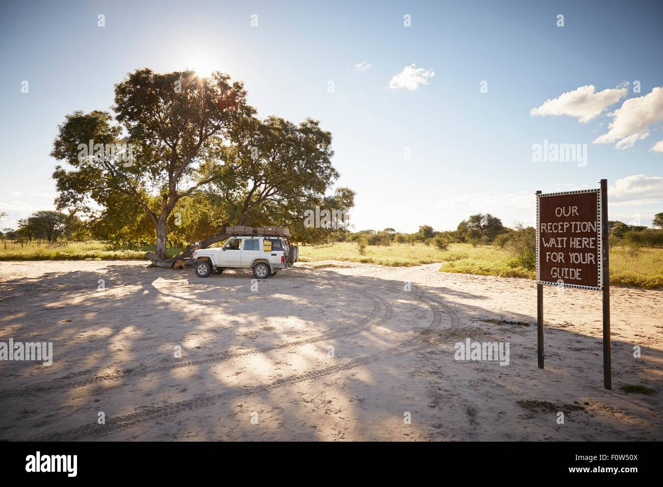Off road vehicle parked by tourist point, Grootfontein, Kavango, Namibia - Stock Image