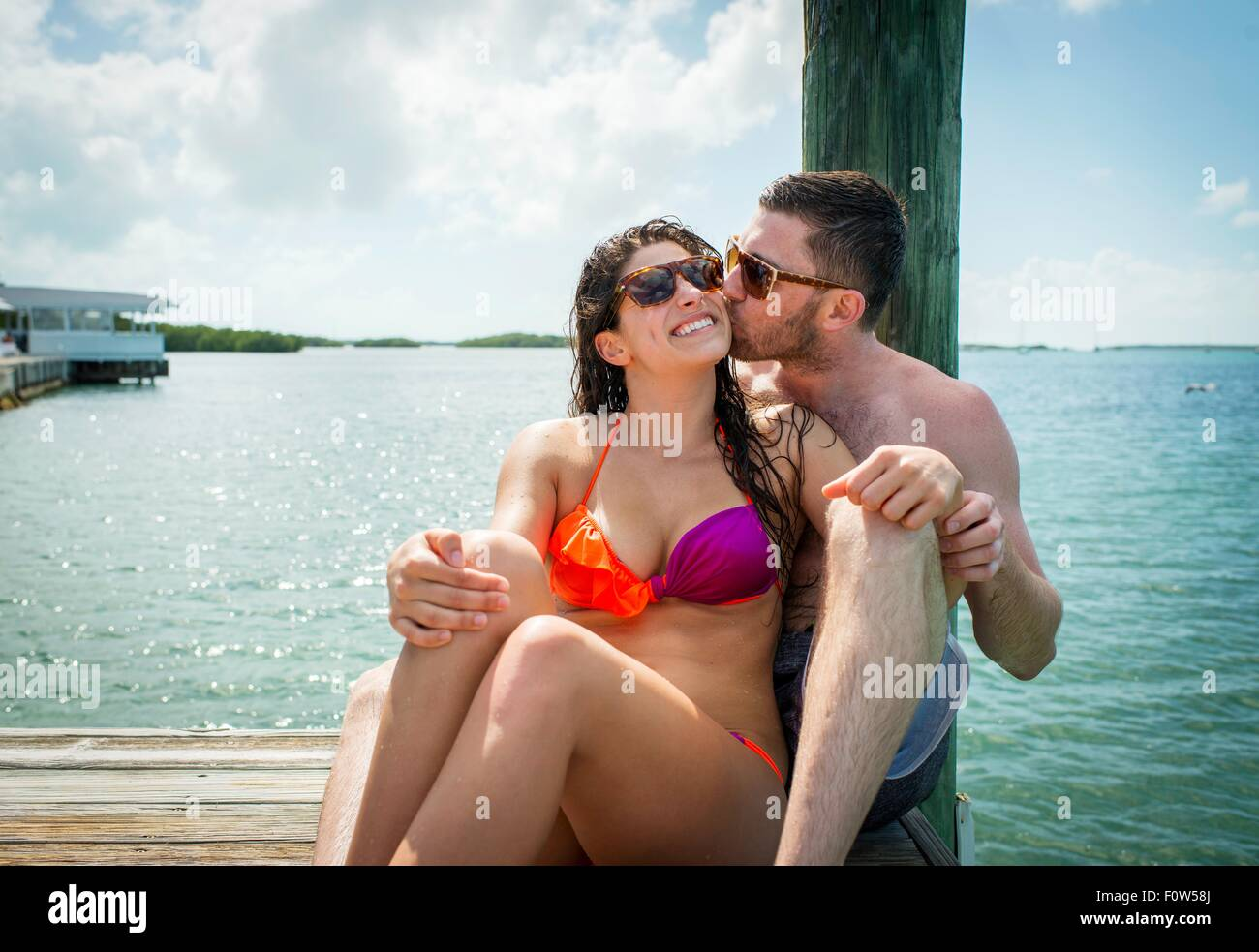 Young couple on sea pier, Islamorada, Florida, USA - Stock Image
