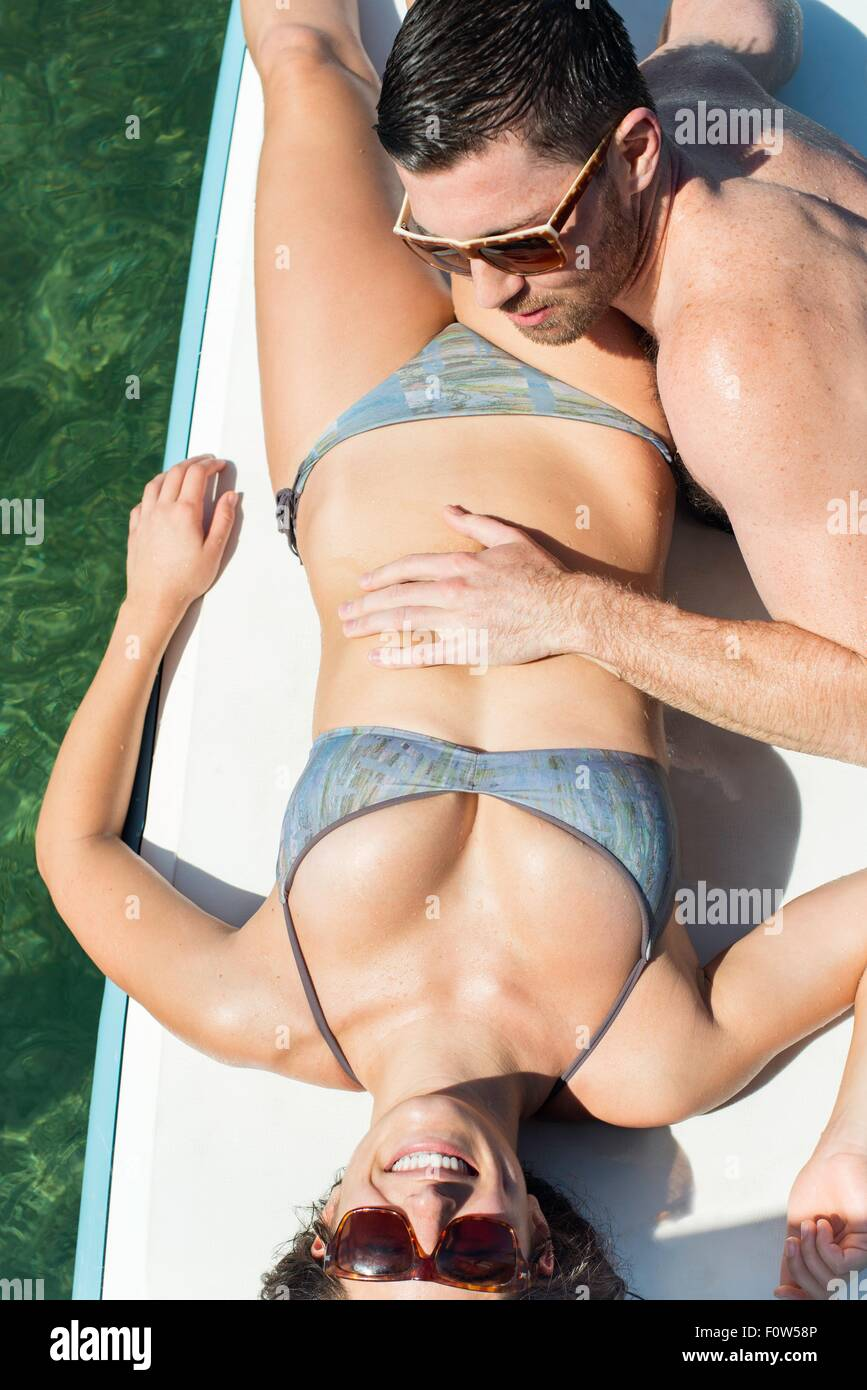 Overhead view of romantic young couple on paddleboards - Stock Image