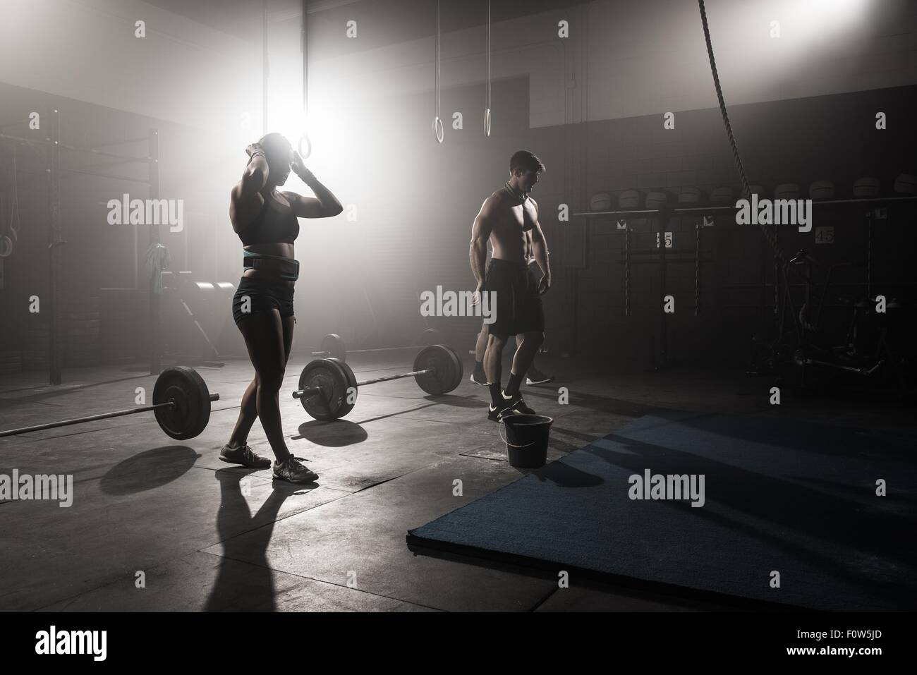 Group of people working out in gym - Stock Image
