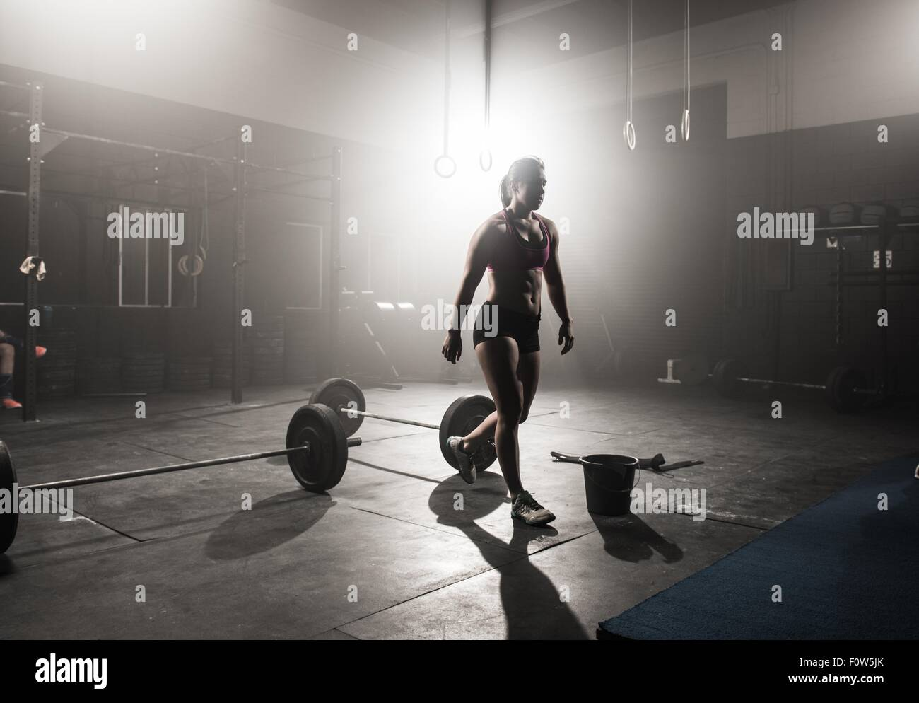 Young woman working out in gym - Stock Image