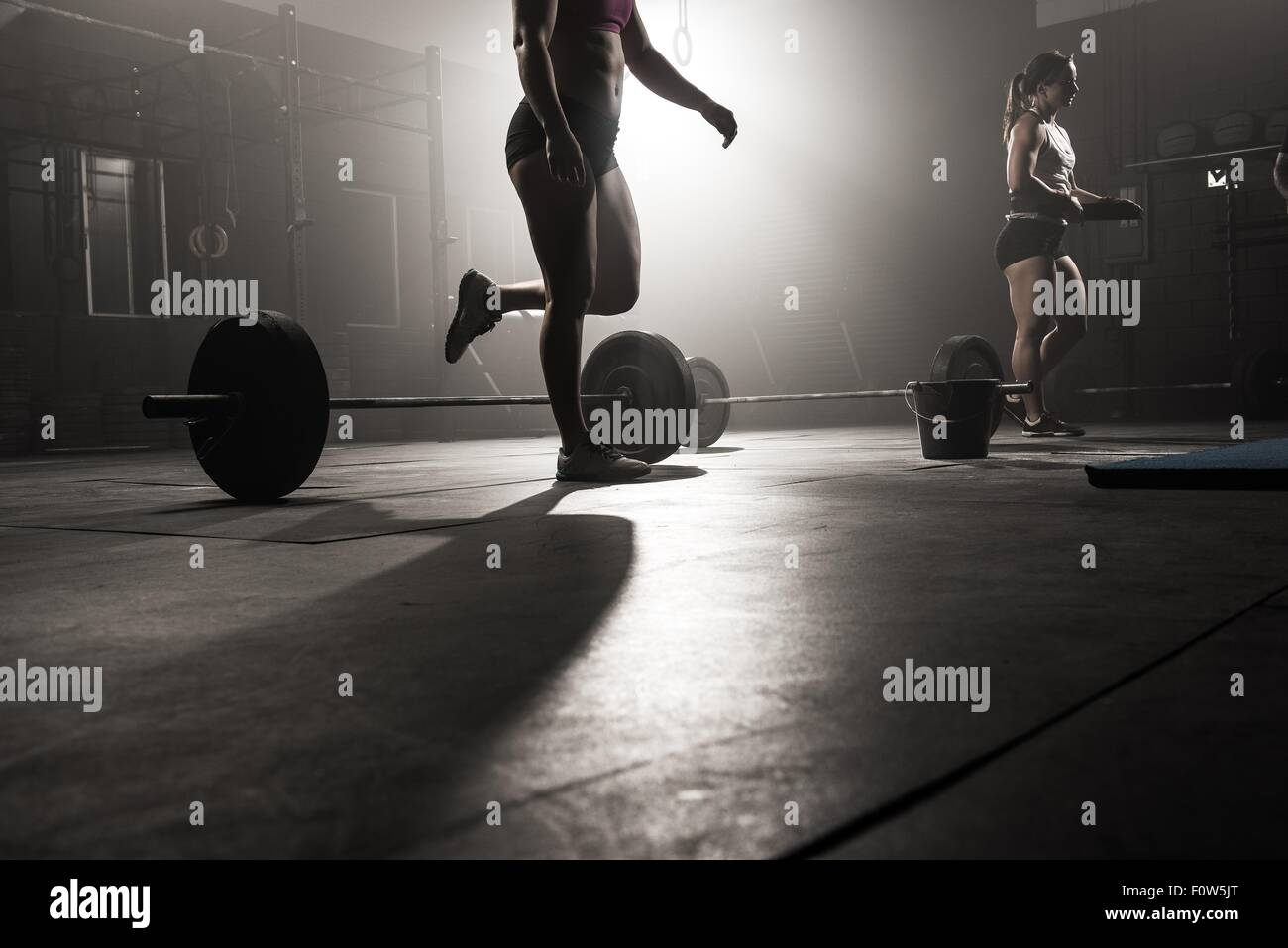 Two young women working out in gym - Stock Image