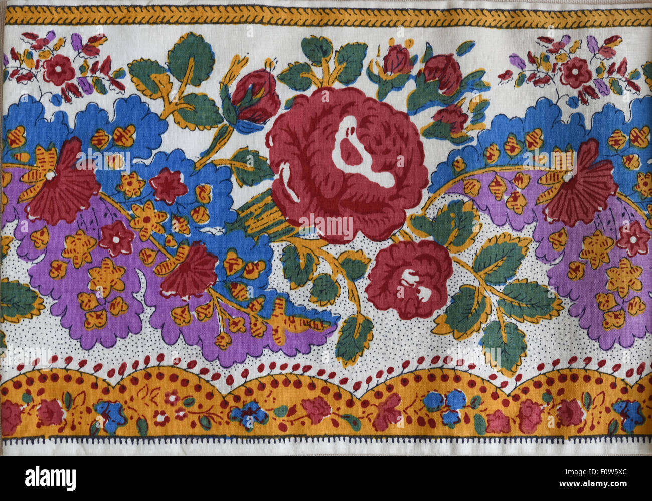 Souleiado Provencal cotton border fabric designed and produced in France. - Stock Image