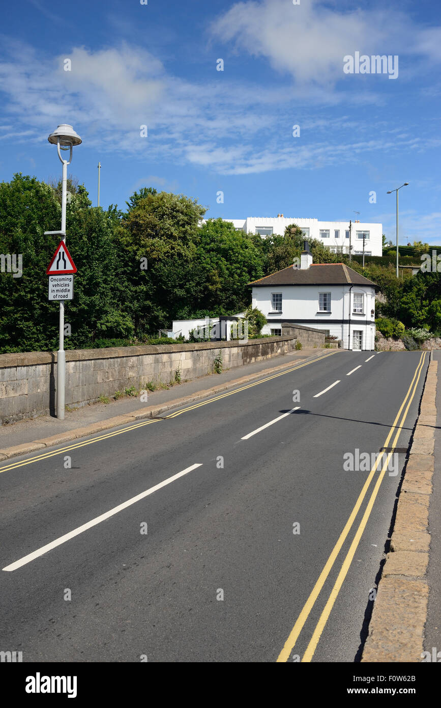 Shaldon bridge, over the river Teign, looking towards the old toll house. - Stock Image