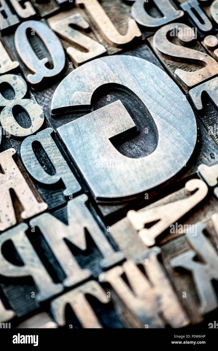 Wooden typographical alphabet letters and numbers - Stock Image
