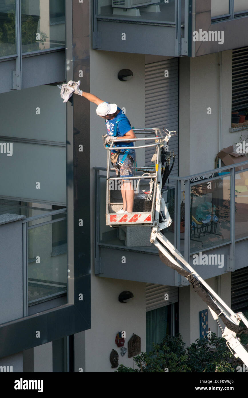Workman on an elevated mechanical platform - Stock Image