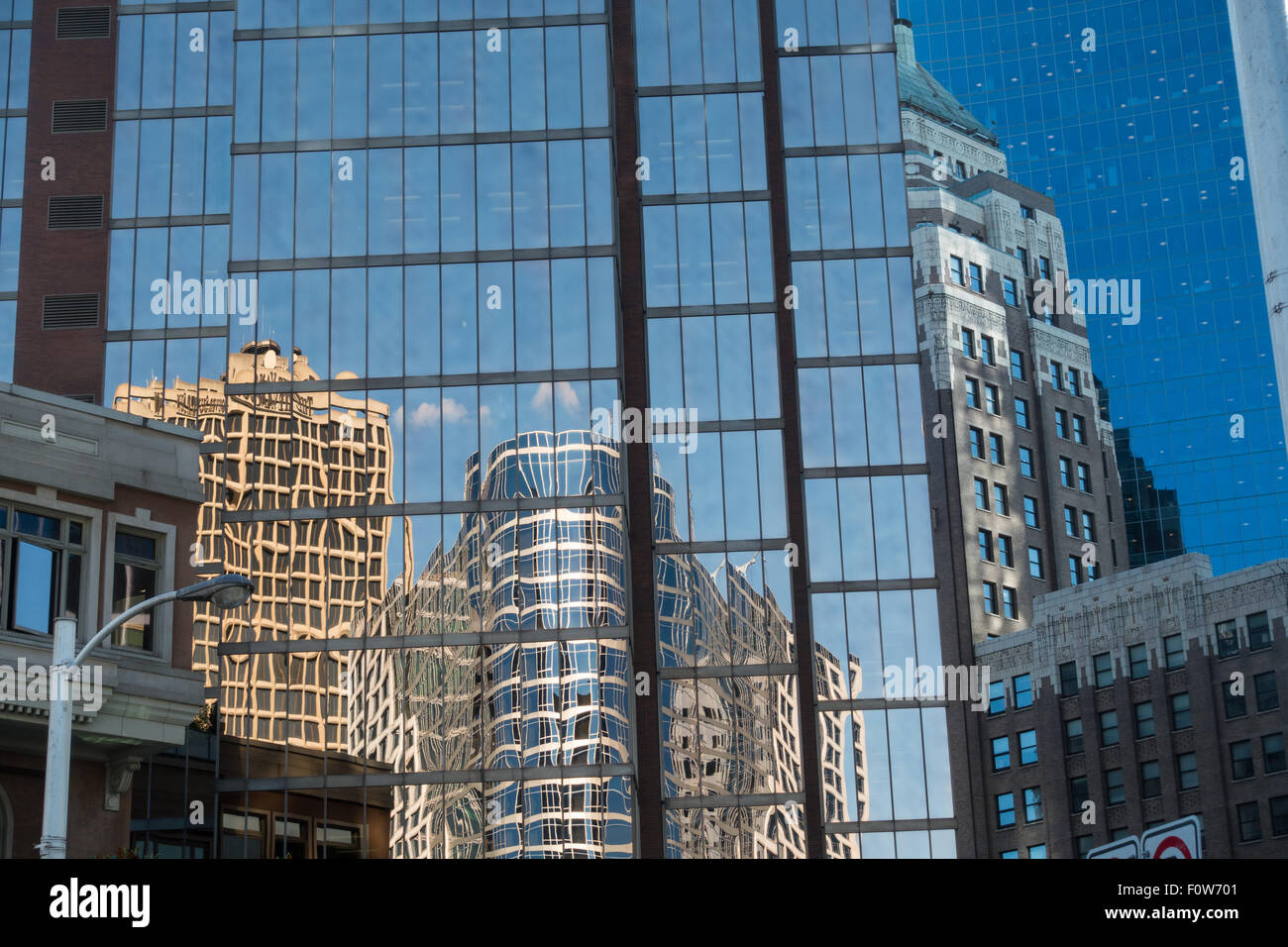Buildings reflected in downtown Vancouver glass hi-rises - Stock Image