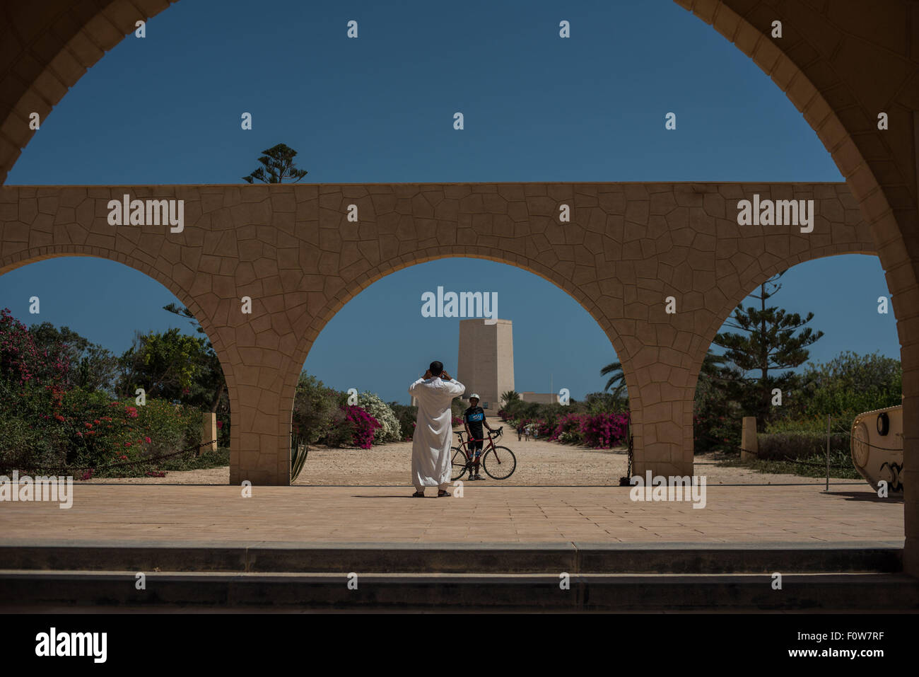 (150822) -- EL ALAMEIN, Aug. 22, 2015 (Xinhua) -- A man takes photos of a visitor at the entrance of the Italian - Stock Image