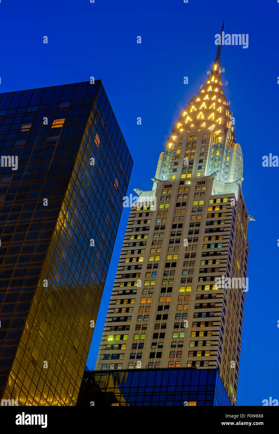 Chrysler Building located in the East side of midtown Manhattan in New York City during the blue hour before sunrise. - Stock Image