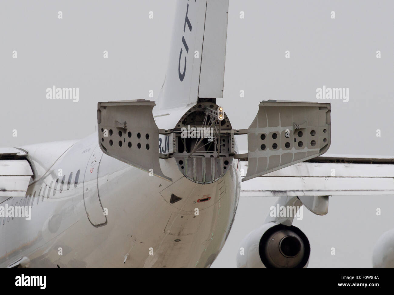 A CityJet Avro RJ85 registration EI-RJI deploys its tail air brake as it comes in to land at London City Airport - Stock Image
