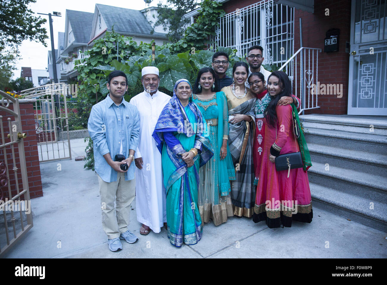 Bangladeshi American family dressed for the Eid holiday celebration after the month of Ramadan. - Stock Image