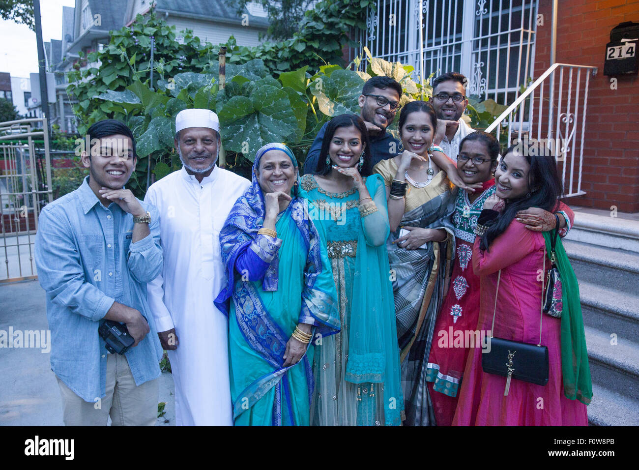 Bangladeshi American family dressed for the Eid holiday celebration after the month of Ramadan goofing around for - Stock Image