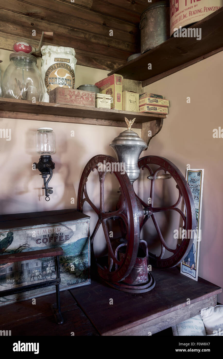 An antique coffee mill found at a general store back in the days. - Stock Image