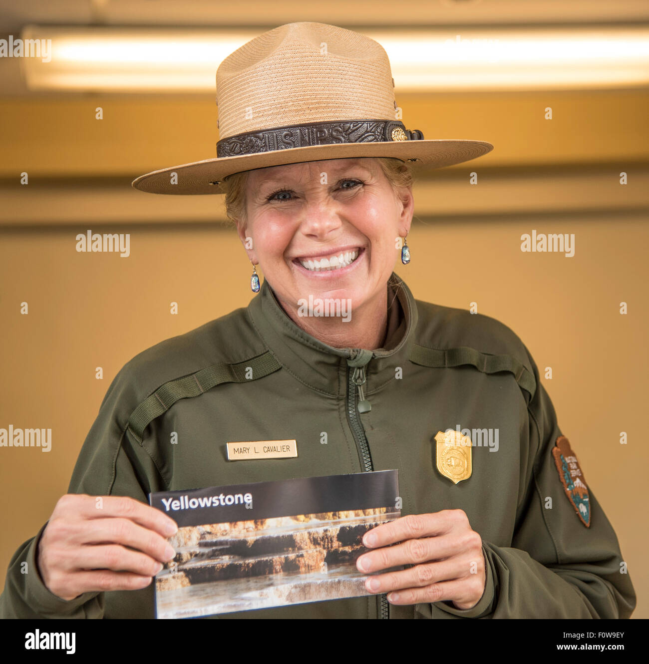 Yellowstone National Park, Park Ranger  Mary l. Cavalier greeting visitors at the park entrance West Yellowstone, - Stock Image