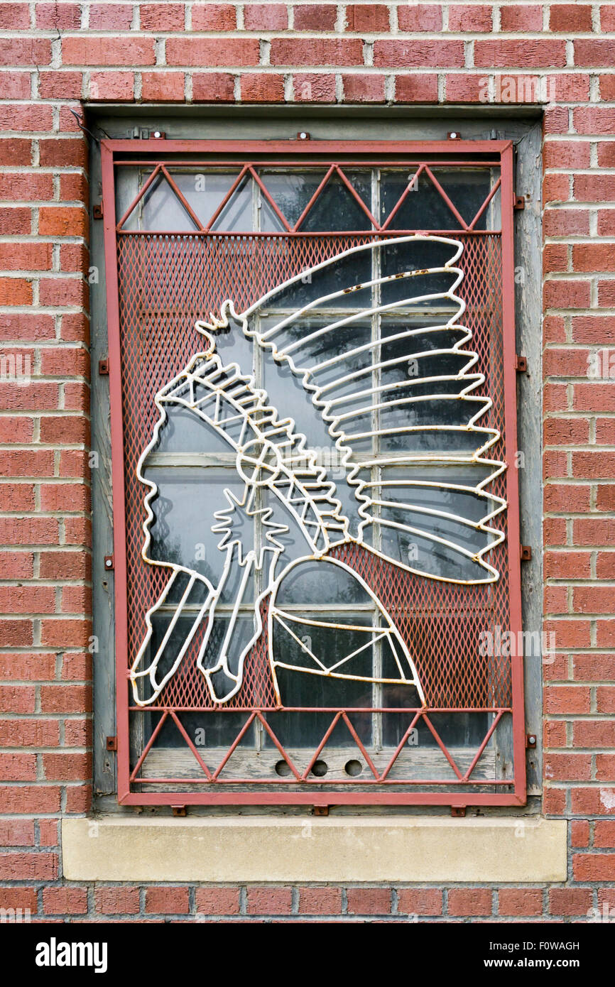 Decorative metal screen on window of the Blackfeet Historical Society in Browning, Montana. - Stock Image