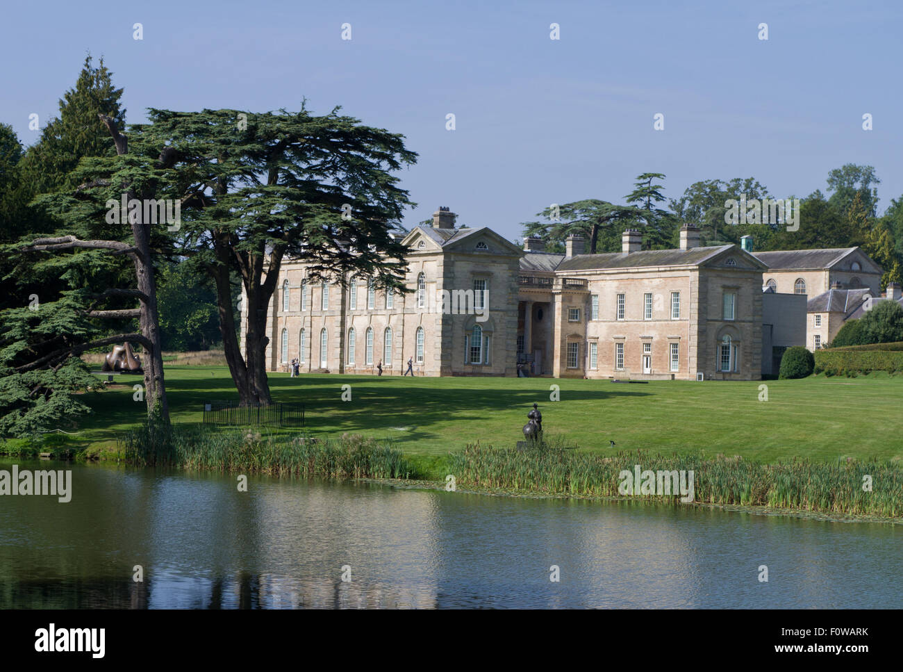 Compton Verney House in Warwickshire seen from across the lake; it now houses an award winning art gallery. - Stock Image