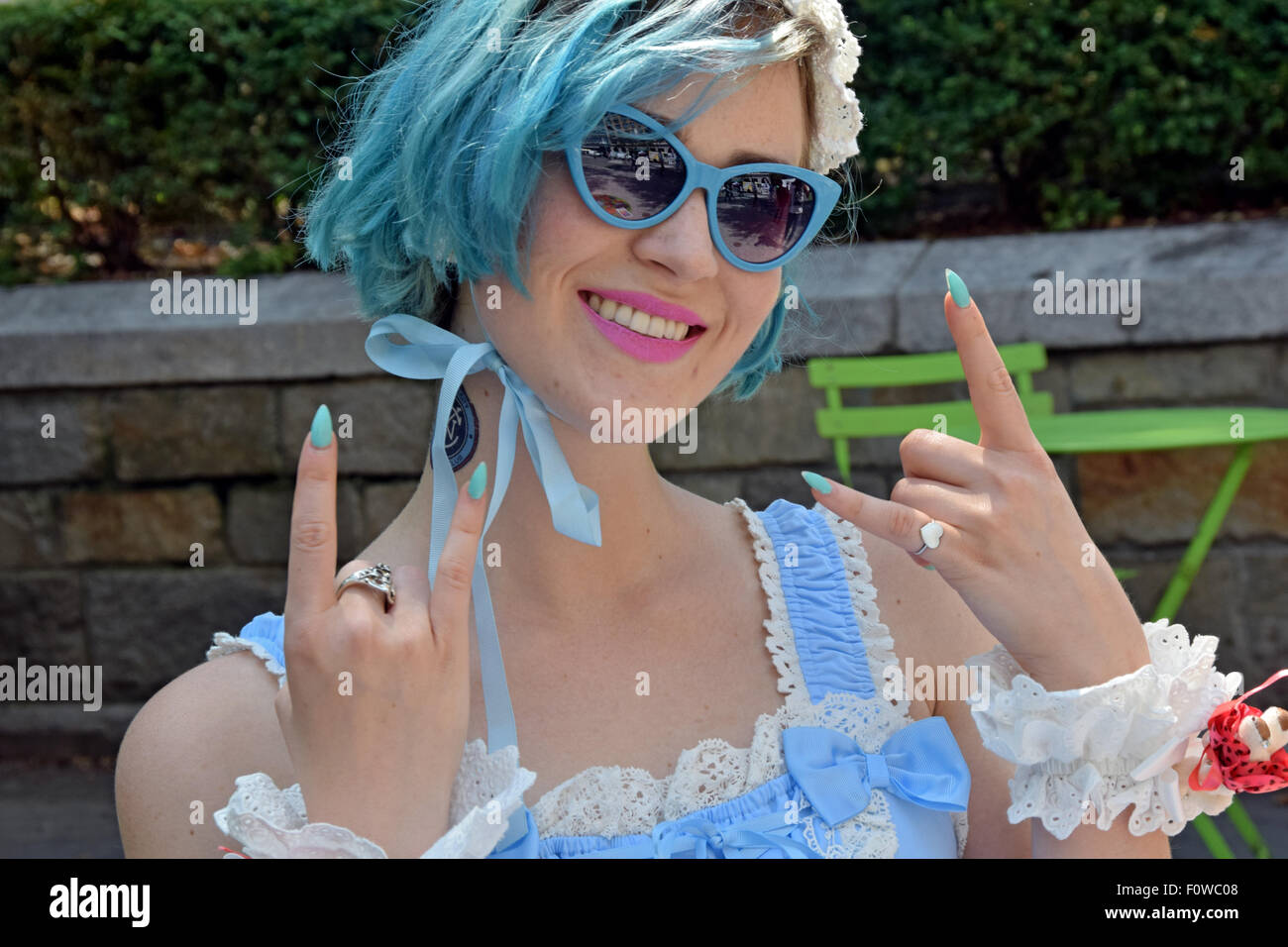 A performance artist dressed in light blue with light blue hair and fingrer nails,  at Union Square Park in New - Stock Image