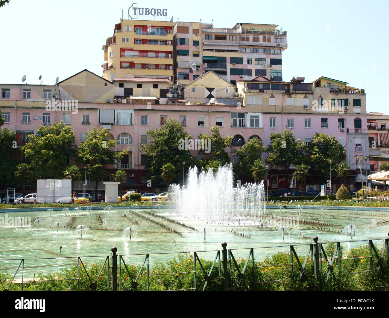 Tirana, Albania. Residential building and fountain in the city center. - Stock Image